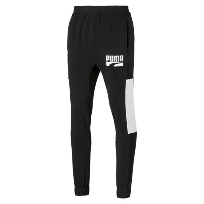 PUMA Rebel Block cl FL men trousers, Colour: Black, Material: cotton, Graphic rubber print Rib waistband with internal drawcords for customized comfort Side pockets for storage solutions Gusset for improved comfort Elastic cuffs Regular fit with tapered leg