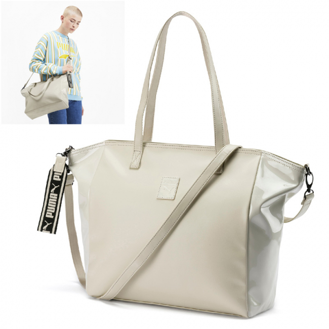 PUMA Prime Premium Large women bag, Colour: light beige, Material: polyurethane, Timeless design, striking features. This style combines an established silhouette with a glossy front panel and rich metal trims. Key highlight is the chunky jaquard keyring that adds to the unique look of this bag, but can also be used separately.