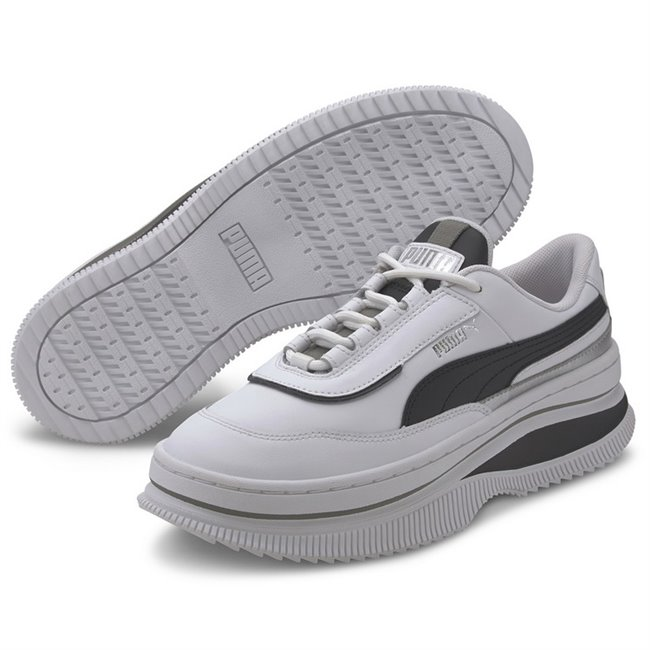 PUMA Deva Mono Pop Shoes, Color: white, black, Material: leather, The Deva is an elevated sport-fashion silhouette inspired by rebellious punk attitude and chunky, oversized streetwear shoes seen in Tokyo. It plays with height and materials to create a totally new look: the top line tooling is a sneaker while the sole is high fashion. This execution features a leather upper with metallic detail in the quarter heel.