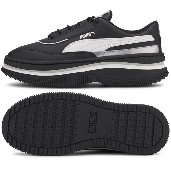 PUMA Deva Mono Pop Shoes, Color of product: black, white, Material: leather, synthetic fibers, The Deva is an elevated sport-fashion silhouette inspired by rebellious punk attitude and chunky, oversized streetwear shoes seen in Tokyo. It plays with height and materials to create a totally new look: the top line tooling is a sneaker while the sole is high fashion. This execution features a leather upper with metallic detail in the quarter heel.